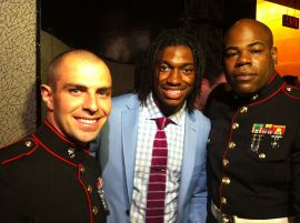 Draftee Robert Griffin III poses with marines at the 2012 draft. (Wikimedia Commons)