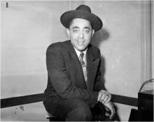 """Portrait of Wendell Smith  c. 1938-1945. Photo by Charles """"Teenie"""" Harris. Courtesy of Carnegie Museum of Art."""