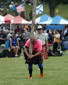 Caber Toss at 2014 Grandfather Mountain Highland Games, photo by James Shaffer, (www.gmhg.org)