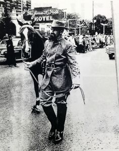 The MTSU Nathan Bedford Forrest mascot marches in the 1961 homecoming parade.