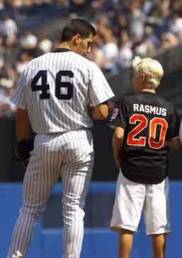 New York Yankees pitcher Andy Pettitte, (46), talks to Colby Rasmus, (20) of the Phenix, Ala., Little League team who were runners up in Saturday's Little League World Series Championship game before the Yankees game against the Seattle Mariners, Sunday, Aug. 29, 1999, at Yankee Stadium in New York.(AP Photo/Kathy Willens)