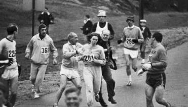 Jock Semple aims to extricate Kathrine Switzer from the 1967 Boston Marathon.
