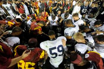 Members of the Southern California and Penn State football teams pray after the Rose Bowl NCAA college football game in Pasadena, Calif., Thursday, Jan. 1, 2009. USC won 38-24. (AP Photo/Chris Carlson)