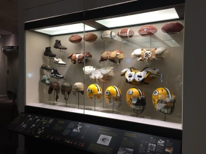 Display of changes in athletic equipment at the Green Bay Packers Hall of Fame.