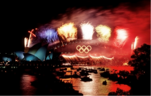 The opening ceremony of the 2000 summer Olympics in Sydney, Australia; featuring the iconic Sydney Harbour Bridge and Sydney Opera House. Image courtesy of Wikimedia Commons.