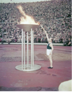 "The ""Flying Finn"", Paavo Nurmi, lights the Olympic cauldron at the 1952 Helsinki Games. Image courtesy Wikimedia commons."