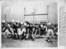 """""""A press photo of German prisoners of war playing American football at the Stockton Ordnance Depot Prisoner of War Camp. 14 January 1946."""" Courtesy of California Military Department Museum."""